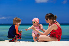 Family playing on tropical beach Royalty Free Stock Image