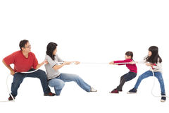Family playing tug of war. Happy family playing tug of war stock photography