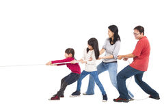 Family playing tug of war. Happy family playing tug of war stock images