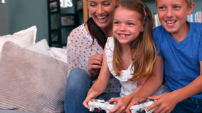 Family playing video game. At home stock footage