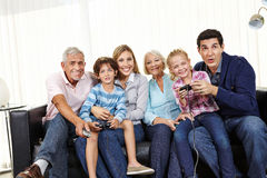 Family playing video game together on Smart TV Royalty Free Stock Image