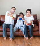 Family playing video games Stock Images