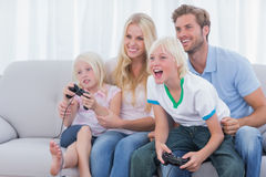 Family playing video games. In the living room royalty free stock photos