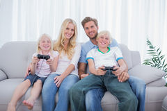 Family playing video games together. In the living room stock photography