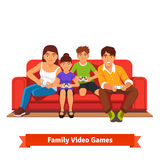 Family playing video games together Royalty Free Stock Photography