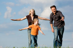 Family playing at a walk Royalty Free Stock Photo