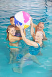 Family playing with water ball in pool Royalty Free Stock Images