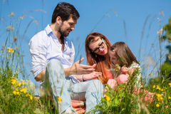 Family playing with wildflowers on meadow Royalty Free Stock Images