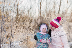 Family playing in winter outdoors Royalty Free Stock Images