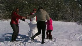 Family Playing in Winter Snow stock video footage