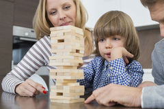 Family playing with wooden blocks at home Stock Photos