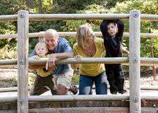Family playing on wooden bridge Stock Images