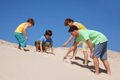 Family plays on the beach, found something. Summer day Royalty Free Stock Photography