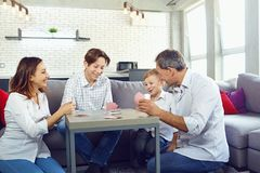 The family plays board games inside the room.