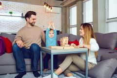 The family plays board games in the room. The family plays board games together in the room Stock Image