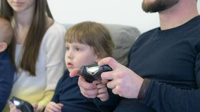 The family plays the console Royalty Free Stock Photo