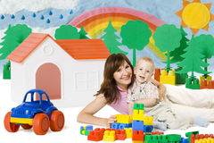 Baby Mother Play Lego Blocks Toys in Home, Family House Car. Baby and Mother Play Lego Blocks Toys in Home, House Car Family wellbeing concept Royalty Free Stock Photography