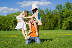 The family plays on nature Royalty Free Stock Image