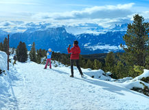 Family plays at snowballs on winter mountain slope Royalty Free Stock Photography