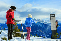 Family plays at snowballs on winter mountain slope Stock Photography