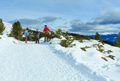 Family plays at snowballs on winter mountain slope Royalty Free Stock Image