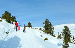 Family plays at snowballs on winter mountain slope Royalty Free Stock Photo