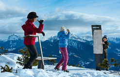 Family plays at snowballs on winter mountain slope Royalty Free Stock Photos