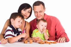 Family plays at table Royalty Free Stock Images