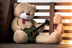 Family of plush teddy bears with a guitar. Stock Photos