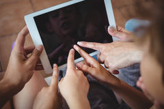 Family pointing their fingers at digital tablet Stock Photos