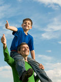 Family pointing thumbs up stock photo
