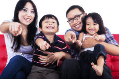 Family pointing at you Stock Photo