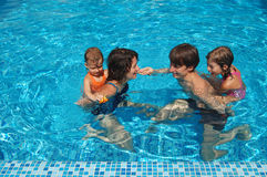 Family in the pool Royalty Free Stock Photos