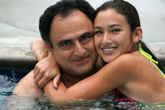 Family in a pool. Father and daughter in the swimming pool Stock Image