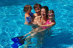 Family in the pool Stock Photo