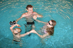 Family in pool. Family with child in pool Royalty Free Stock Image
