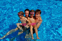 Family in the pool. Family time in the swimming pool Royalty Free Stock Images
