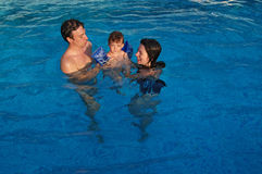 Family in the pool Stock Photography