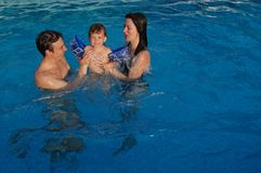 Family in pool Stock Images