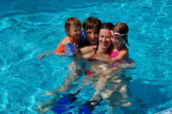 Family in the pool Royalty Free Stock Image