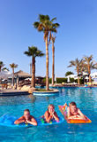 Family in the pool Royalty Free Stock Images