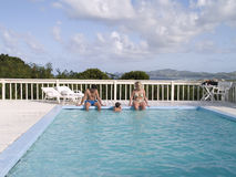 Family in the Pool. A family outside enjoying a private pool Stock Image