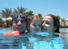 Family at the pool Stock Photos