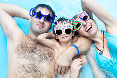 Family in a pool. Family fun in the pool aqua center Stock Photography