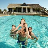 Family at pool. Royalty Free Stock Photos