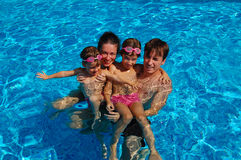 Family pool fun. Family with two kids having fun in swimming pool Stock Images