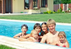 Family in the pool Stock Image