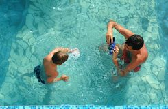 Family in pool take pictures Royalty Free Stock Photo