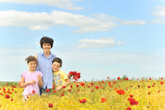Family on poppy field Royalty Free Stock Photos