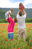 Family in poppy field Stock Photography